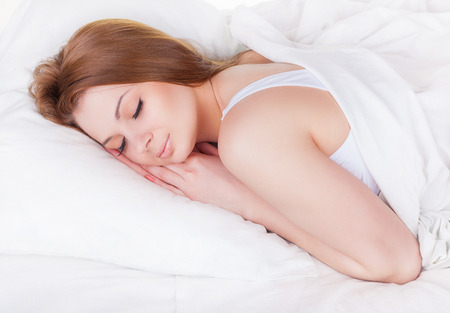 woman laying: Attractive young woman sleeping in bed Stock Photo