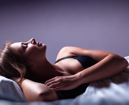 wellness sleepy: Attractive young woman sleeping in bed Stock Photo