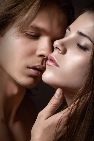 erotic couple: Kissing young couple on a dark