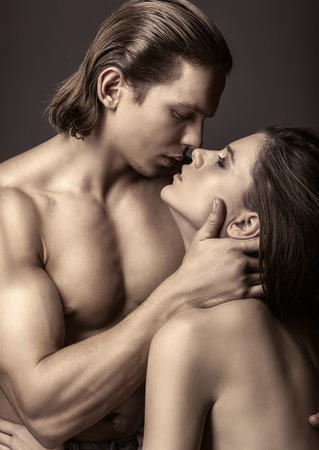 erotic couple: Young beautiful loving couple is embracing