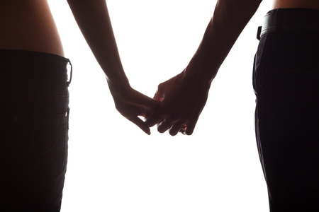 Holding hands couple isolated on white