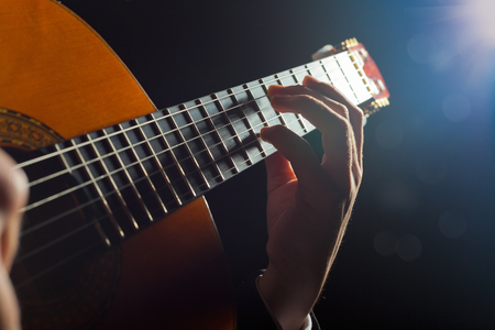 musical instrument parts: Playing the guitar. Musical instrument with performer hands