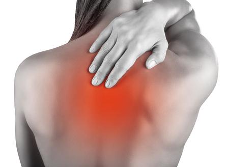 mujer desnuda de espalda: Woman massaging pain back isolated on white background Foto de archivo