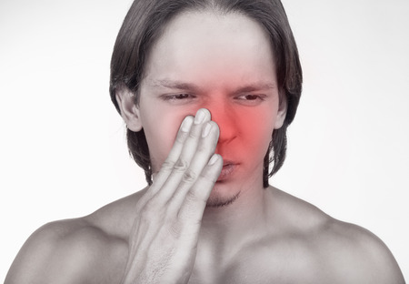 head pain: Sick man having trouble with sinus pain isolated on white background