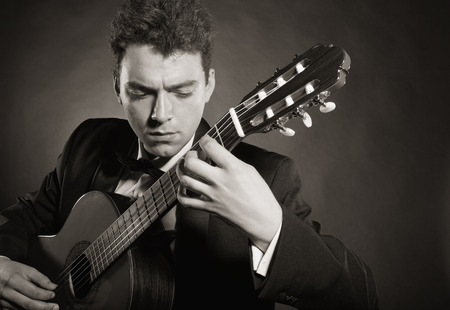 playing the guitar: Man playing guitar. Black and white photo