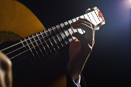 stage performer: Playing the guitar. Musical instrument with performer hands