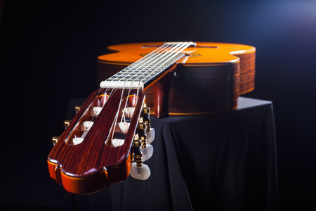 musical instrument parts: Close-up of classical guitar on a dark background Stock Photo