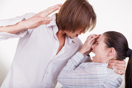 sexual violence: Young man beats his woman. Woman victim of domestic violence and abuse