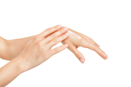 Woman applies cream on her hands isolated on white background