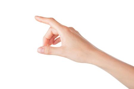 白い背景に分離された仮想画面に触れる女性手