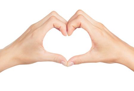 saint valentin coeur: Mains des femmes dans la forme de coeur isol� sur fond blanc Banque d'images