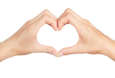 dando la mano: Manos femeninas en forma de corazón aislado en el fondo blanco Foto de archivo
