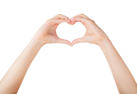 love concepts: Female hands in the form of heart isolated on white background