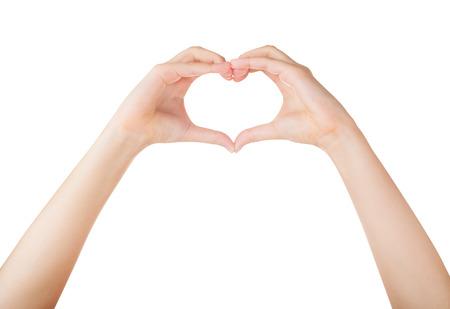 cuore: Mani femminili in forma di cuore isolato su sfondo bianco Archivio Fotografico