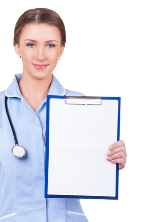 Smiling woman doctor showing blank clipboard sign isolated on white background photo