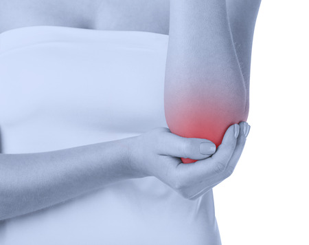 elbow pain: Woman with pain in the elbow isolated on white background. Front view Stock Photo