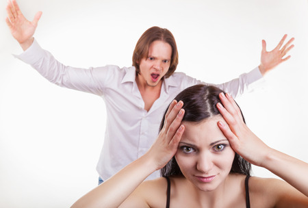 rant: Furious, the husband yells at his wife, on a white background. Focus on girl Stock Photo