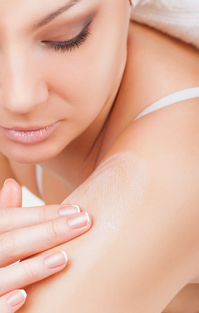 sensitive skin: Close-up woman caring about her arm applying cosmetic cream
