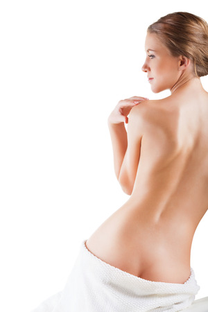 Beautiful back of a young woman after shower isolated on white background Stock Photo