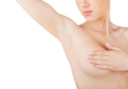 nude female figure: A young woman shows her clean armpit isolated on white background