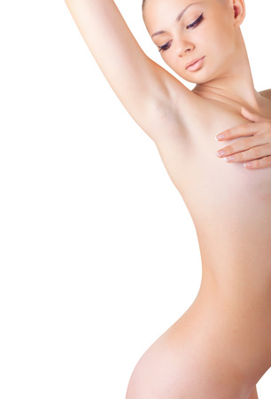 Young woman looking at her clean armpit isolated on white background