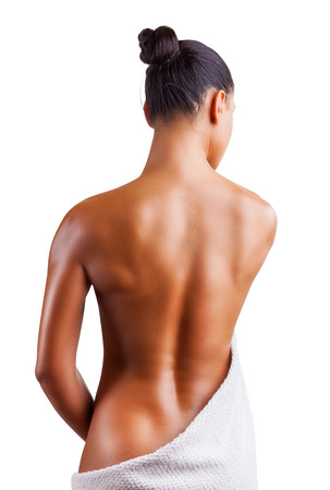 naked women: Beautiful back of a young woman isolated on white background