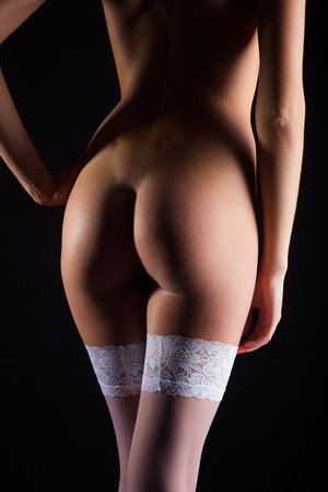 naked legs: Perfect female body on dark background. Back Stock Photo