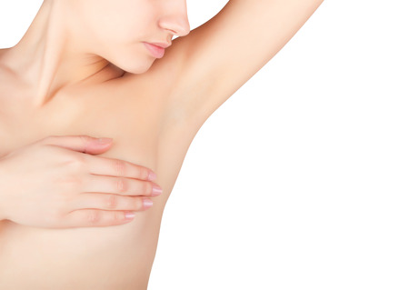 breasts: A young woman shows her clean armpit isolated on white background