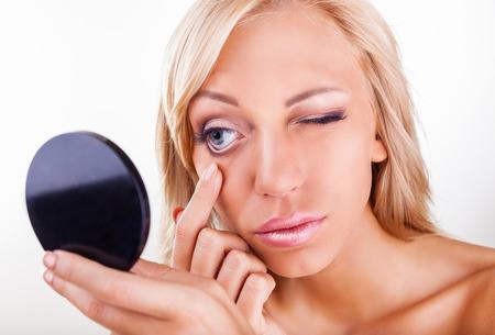 wearer: Young woman checks a contact lens in her eye
