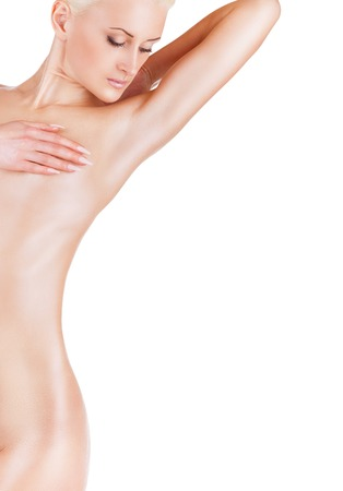 naked woman  white background: Young woman looking at her clean armpit isolated on white background