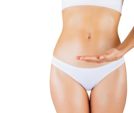 corps femme nue: Belle jeune femme en culotte blanche isol� sur fond blanc. Focus sur la main Banque d'images