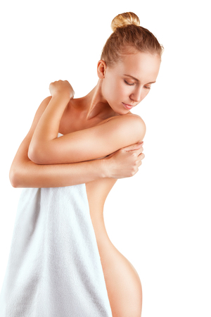 naked woman  white background: Well-groomed young woman in towel isolated on white background Stock Photo