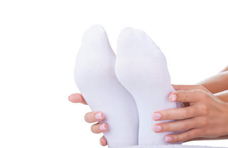 Woman wearing socks for foot care isolated on white background