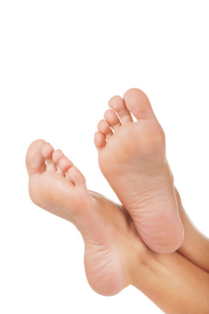 feet naked: Beautiful well-groomed female a foot and a heel on a white background