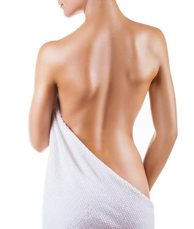 naked young woman: Belle dos d'une jeune femme isol�e sur fond blanc