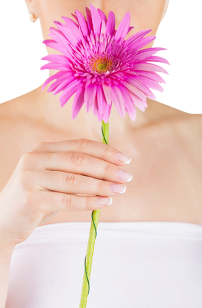bodypart: Manicured hands of a woman with a flower on a white background