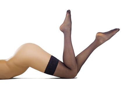 nude female buttocks: Beautiful female legs in stockings isolated on white background Stock Photo