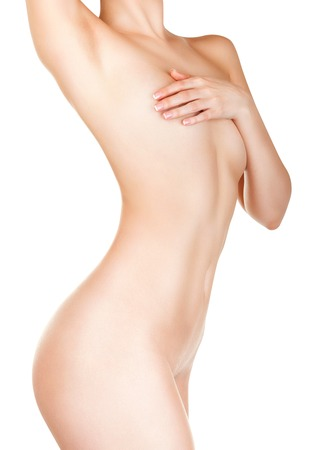 naked belly: Slender figure of a woman with perfect skin isolated on white background Stock Photo
