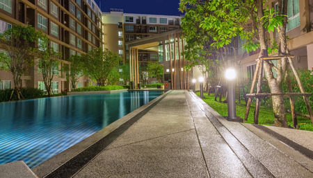 The complex is modern condominium with pool photo