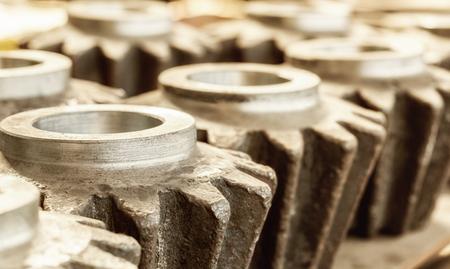interlink: Closeup of blank interconnected industrial metal gears Stock Photo