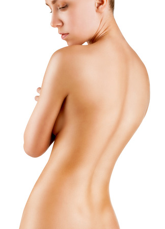 nude female buttocks: Beautiful back of a young woman isolated on white background