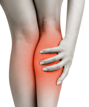 Woman having pain in his leg, isolated on white background