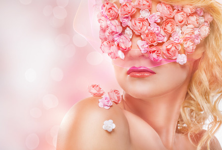 flowers bokeh: Young beautiful blond girl with fashion makeup and pink flowers. Bokeh