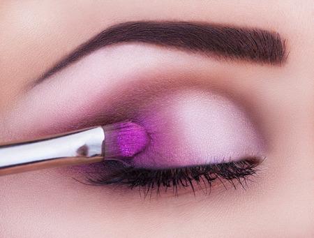 shadow: Close up of eye makeup woman applying eyeshadow powder