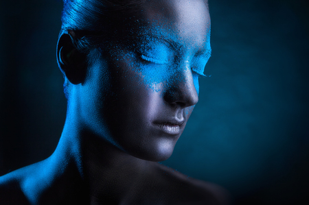 glamour woman: Young woman with black makeup and blue eye shadows Stock Photo