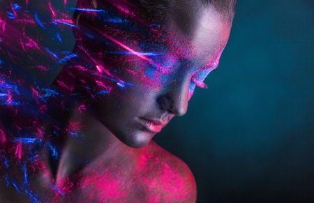 colored powder: Young woman with black makeup on her face and colored shadows