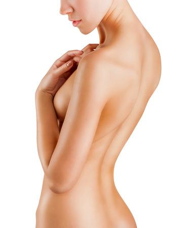 Mooie achterkant van een jonge vrouw die geïsoleerd op wit