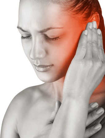 Young woman with ear pain, holding hand on his head. Isolate on white background