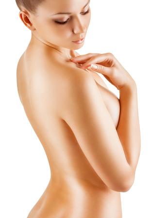mujer desnuda de espalda: Vuelta hermosa de una mujer joven aislado en fondo blanco