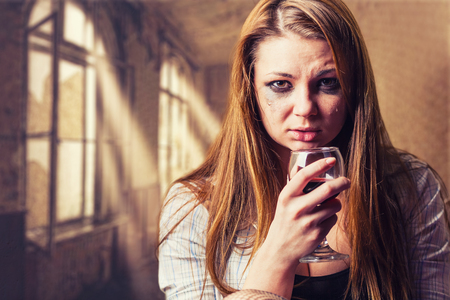 drinking drunk: Young beautiful woman in depression, drinking alcohol Stock Photo